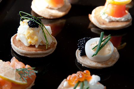 Mixed canapés - blini with a selection of toppings